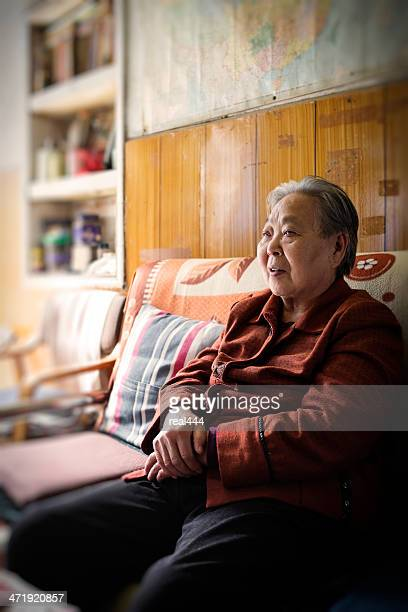 My grandmother resting on the couch