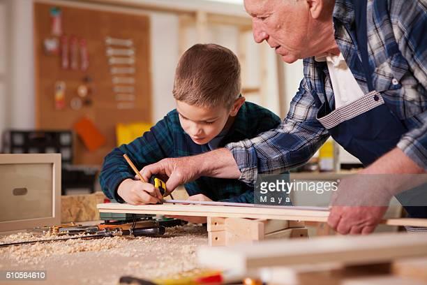 My grandson is little carpenter