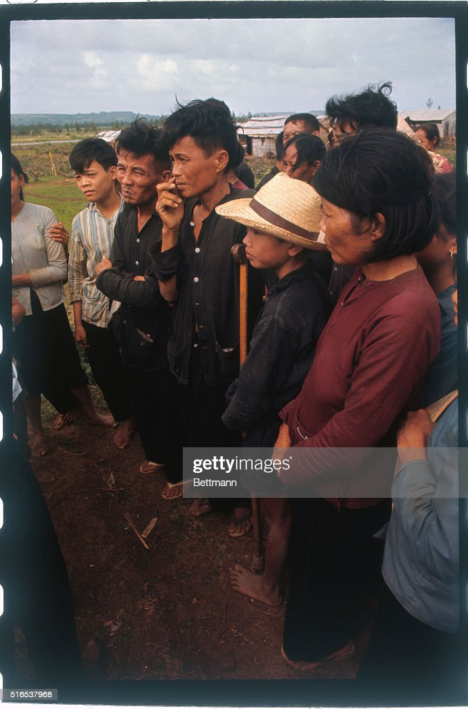 Views of alleged survivors of the My Lai massacre include a man with a crutch, a woman in a red shirt, and a youth in a blue striped shirt, who has two fingers missing, more than a year after the alleged massacre of villagers by U.S. troops.