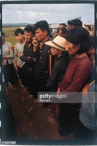 Views of alleged survivors of the My Lai massacre include a man with a crutch a woman in a red shirt and a youth in a blue striped shirt who has two...