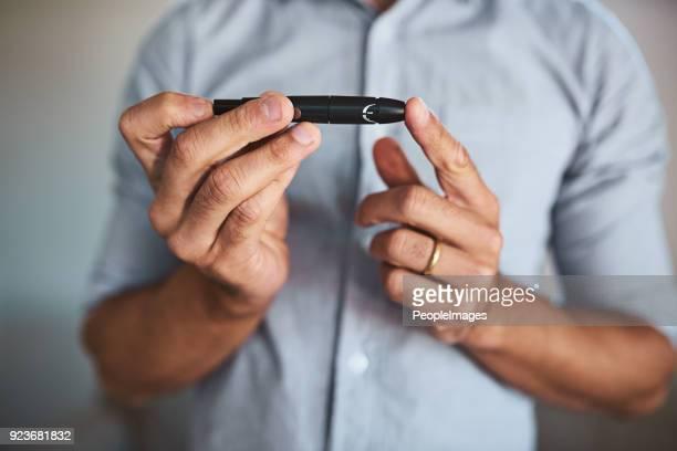 mi pequeño salvavidas - diabetes fotografías e imágenes de stock