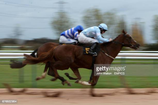 My Mate Jake ridden by Paddy Mulrennan and eventual winner Suddenly Susan ridden by Paul Hanagan race during the I'm A Goth Nursery Handicap Stakes