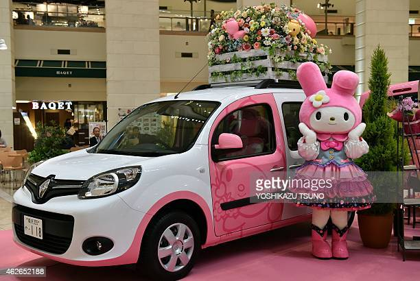 My Melody a character of Japanese character goods maker Sanrio displays a French auto giant Renault's wagon Kangoo with My Melody branding to...