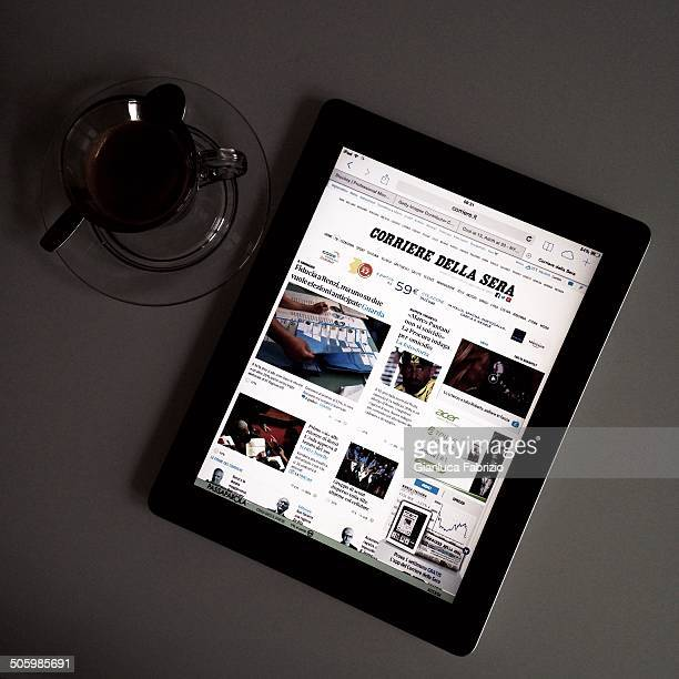 My morning's ritual espresso and Corriere della Sera on the tablet