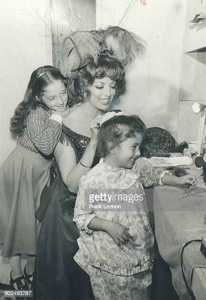 My mother the star Sandra O'Neill's two daughters Aileen 10 left and Alexandra 5 seated at the dressing table visit with her after a rehearsal of...