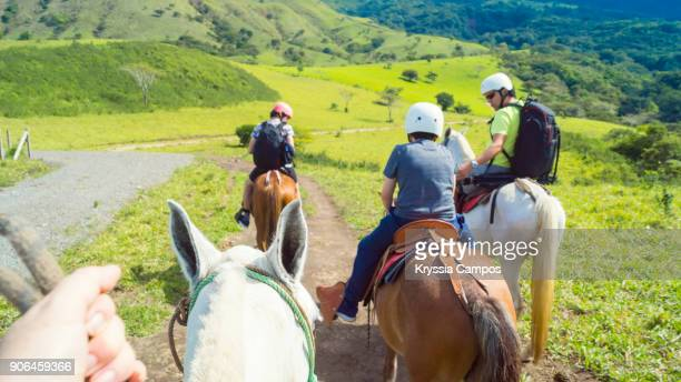 my pov riding a horse - guanacaste stock pictures, royalty-free photos & images