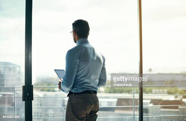 my success will be known to the whole city - man in office stock photos and pictures