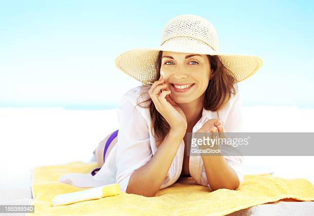 my sun protection routine is a pleasure - sun hat stock pictures, royalty-free photos & images