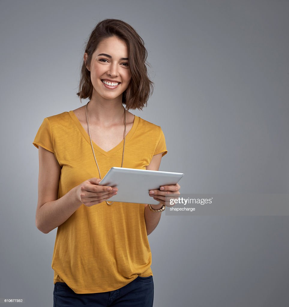 My tablet meets all of my organizational and entertainment needs : Stock Photo