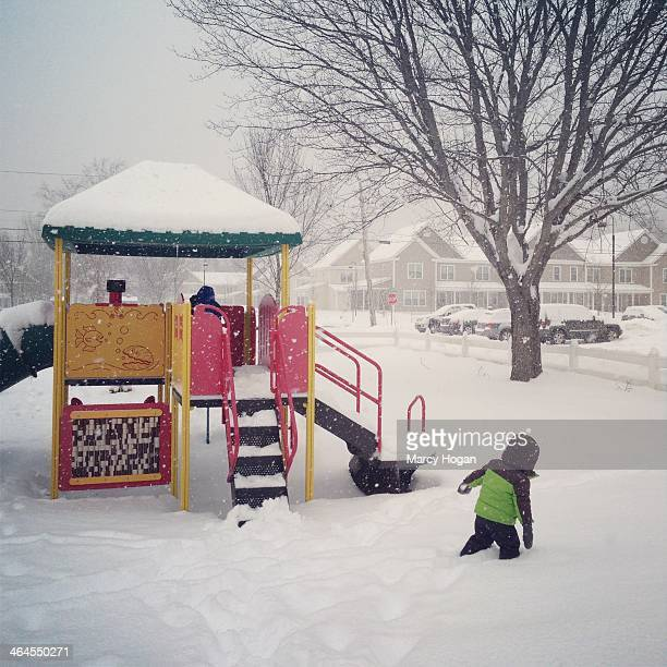 CONTENT] My toddler son walking through thighdeep snow on the playground of our neighborhood
