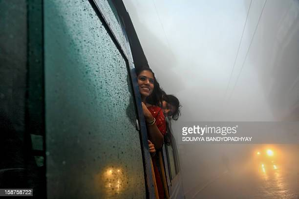 CONTENT] my wife tanaya and her friend debarati looks out of the darjeeling himalayan railway toy train ride this runs from darjeeling to ghoom this...