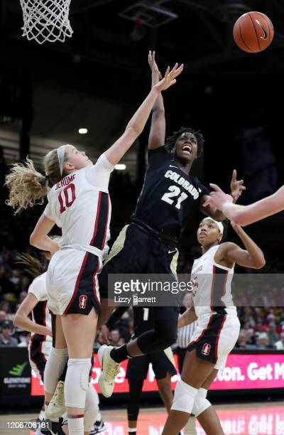 Mya Hollingshed of the Colorado Buffaloes is fouled by Alyssa Jerome of the Stanford Cardinal and loses control of the ball during the third quarter...