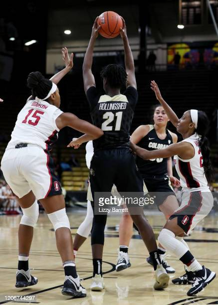Mya Hollingshed of the Colorado Buffaloes looks for open teammates past the defense of Maya Dodson and Kiana Williams of the Stanford Cardinal during...