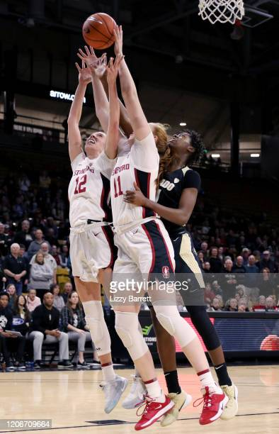 Mya Hollingshed of the Colorado Buffaloes reaches between the arms of Ashten Prechtel and Lexie Hull of the Stanford Cardinal on a rebound during the...