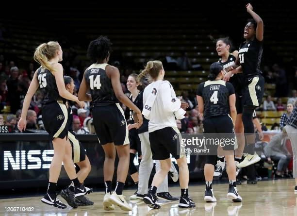 Mya Hollingshed Peanut Tuitele and members of the Colorado Buffaloes celebrate their momentary lead over the Stanford Cardinal during the fourth...