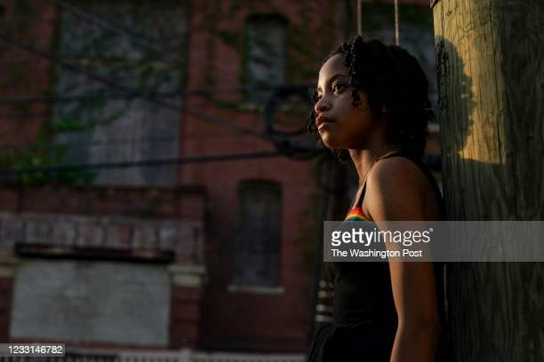 Mya Stuckey stands for a portrait in front of the old Crummell School where she lives in Ivy City on April 27 in Washington, DC. For years, residents...