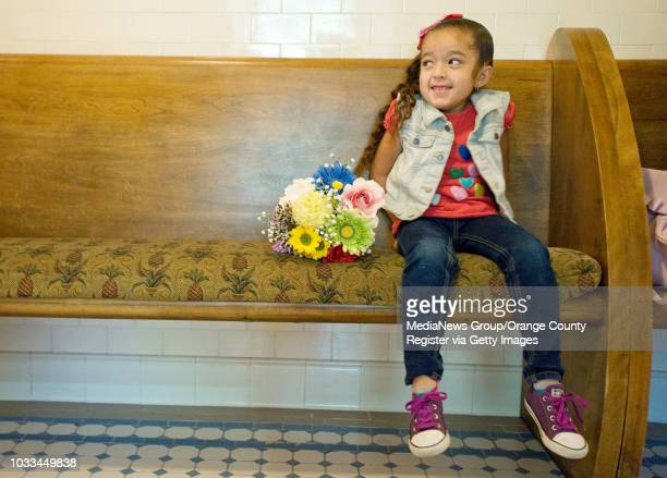 Mya Vallejo waits with a bright bouquet of flowers for the wedding of Lisa and Victor Ornelas to begin The couple met on Valentine's Day 13 years ago...