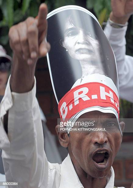 A Myanmar activist wears a portrait of Myanmar democracy icon Aung San Suu Kyi during a protest at the Myanmar embassy in Bangkok on May 27 2009 Aung...