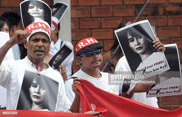 Myanmar activists hold portraits of Myanmar democracy icon Aung San Suu Kyi during a protest at the Myanmar embassy in Bangkok on May 27 2009 Aung...