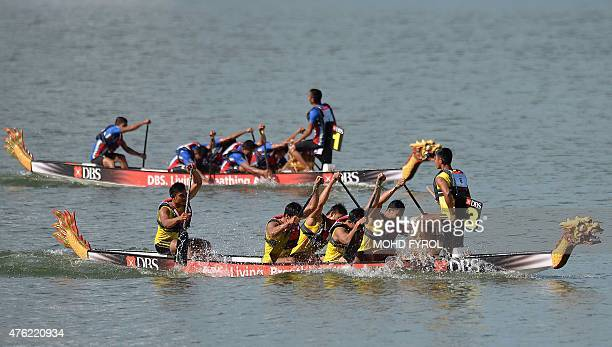 Myanmar and Thailand compete in the men's 6crew 500m tradition boat race event at the 28th Southeast Asian Games in Singapore in June 7 2015 AFP...