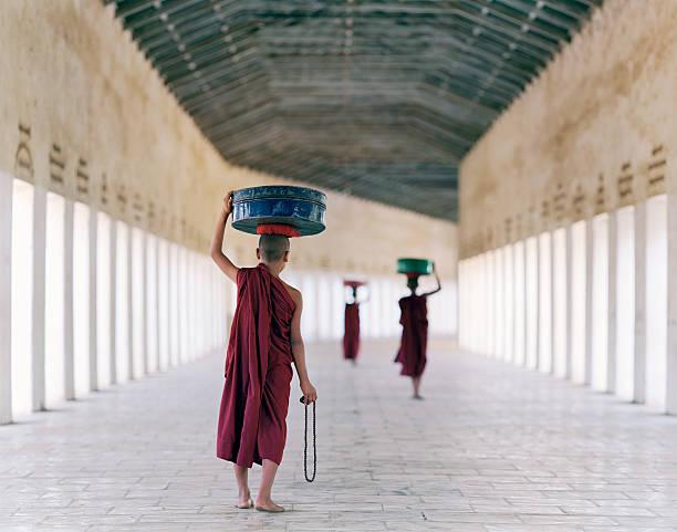 Myanmar, Bagan, monks in temple corridor