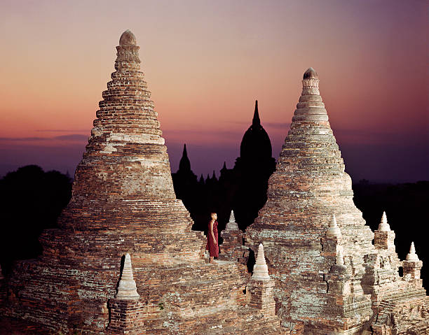 Myanmar, Bagan,Buddhist monk on temple at dawn