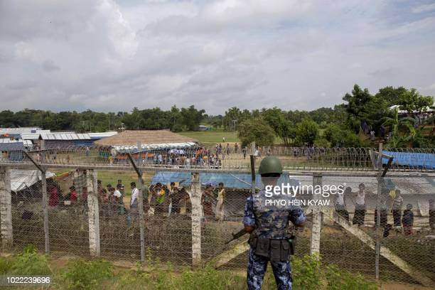 Myanmar border guard police patrol the fence in the no man's land zone between Myanmar and Bangladesh border as seen from Maungdaw Rakhine state...