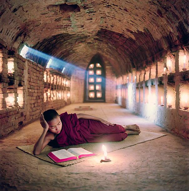 Myanmar, Buddhist monk inside meditation hall