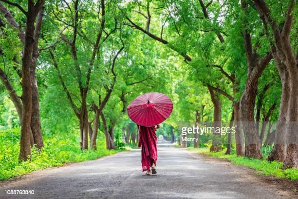 Myanmar Burmese Monk Walking Along Green Alley