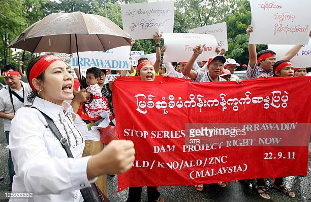 Myanmar citizens living in Malaysia shout slogans and hold placards as they protest in Kuala Lumpur on September 22 2011 against a controversial...