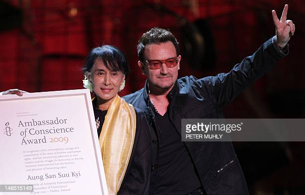 Myanmar democracy icon Aung San Suu Kyi accepts the Ambassador of Conscience Award next to Irish singer Bono at the Bord Gais Energy theatre in...