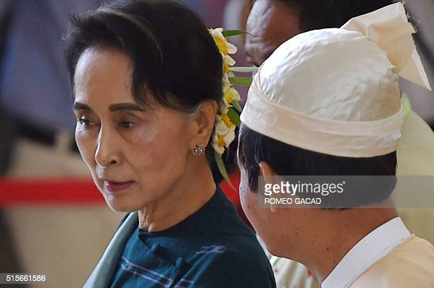 Myanmar democracy icon Aung San Suu Kyi and Win Myint lower house speaker from the National League for Democracy leave parliament in Naypyidaw on...
