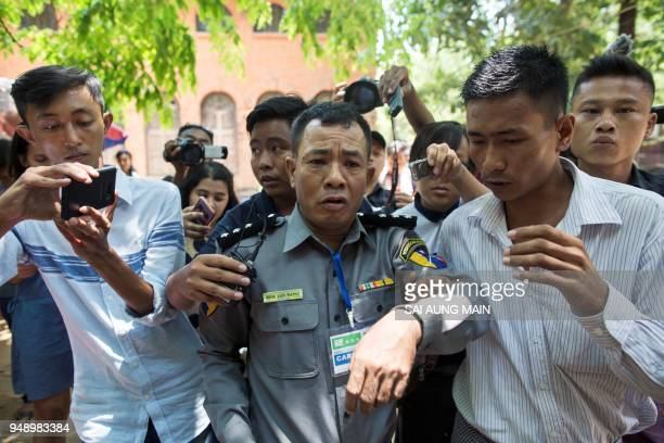 Myanmar deputy police major Moe Yan Naing leaves the court following the ongoing trial of two detained journalists in Yangon on April 20, 2018. - A...