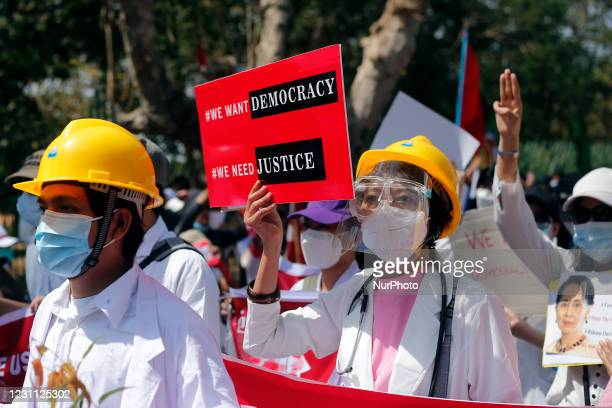Myanmar doctors march as they take part in a demonstration against military coup in Yangon, Myanmar on February 12, 2021.
