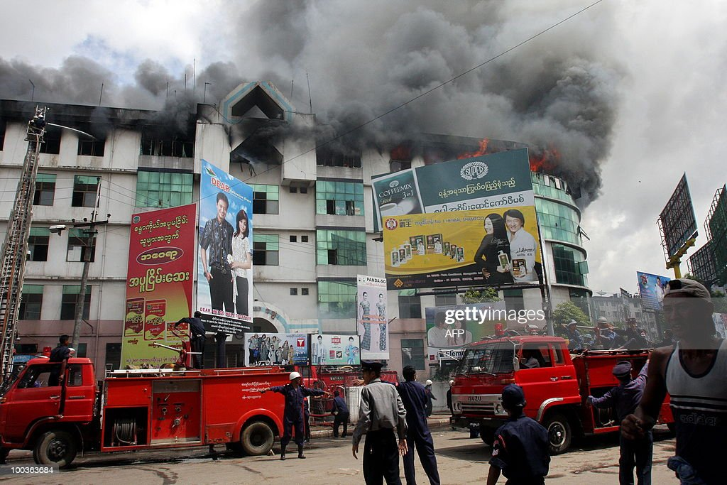 Myanmar firemen reach the site of a fire which broke out at the main market in Yangon on May 24 , 2010. A huge fire broke out at the main market in Myanmar's biggest city Yangon destroying hundreds of shops, but no victims were reported, shop owners and officials said.