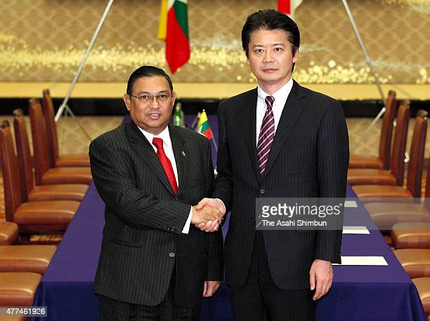 Myanmar Foreign Minister Wunna Maung Lwin and Japanese Foreign Minister Koichiro Gemba shake hands during their meeting at the Iikura Guest House on...