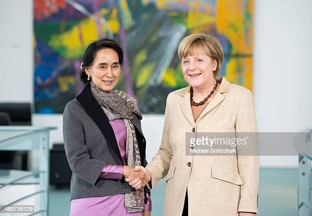 Myanmar human rights activist and politician Aung San Suu Kyi and German Chancellor Angela Merkel meet in the Chancellery on April 10 2014 in Berlin...