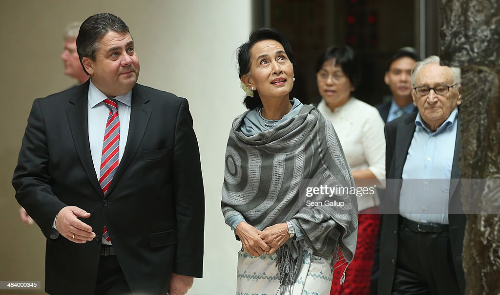 Myanmar human rights activist and politician Aung San Suu Kyi (C) arrives with Vice Chancellor and Economy and Energy Minister as well as Chairman of the German Social Democrats (SPD) Sigmar Gabriel (L) and former SPD politician Egon Bahr (R) at Willy Brandt Haus to receive the SPD's Willy Brandt award on April 11, 2014 in Berlin, Germany. Aung San Suu Kyi is visiting Berlin for the first time before she continues next week to France.