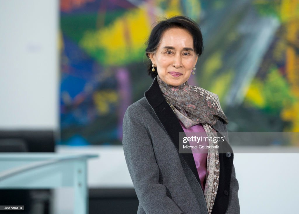 Myanmar human rights activist and politician Aung San Suu Kyi poses as she meets German Chancellor Angela Merkel in the Chancellery on April 10, 2014 in Berlin, Germany. Aung San Suu Kyi is on a two-day visit to Germany before she continues to France.