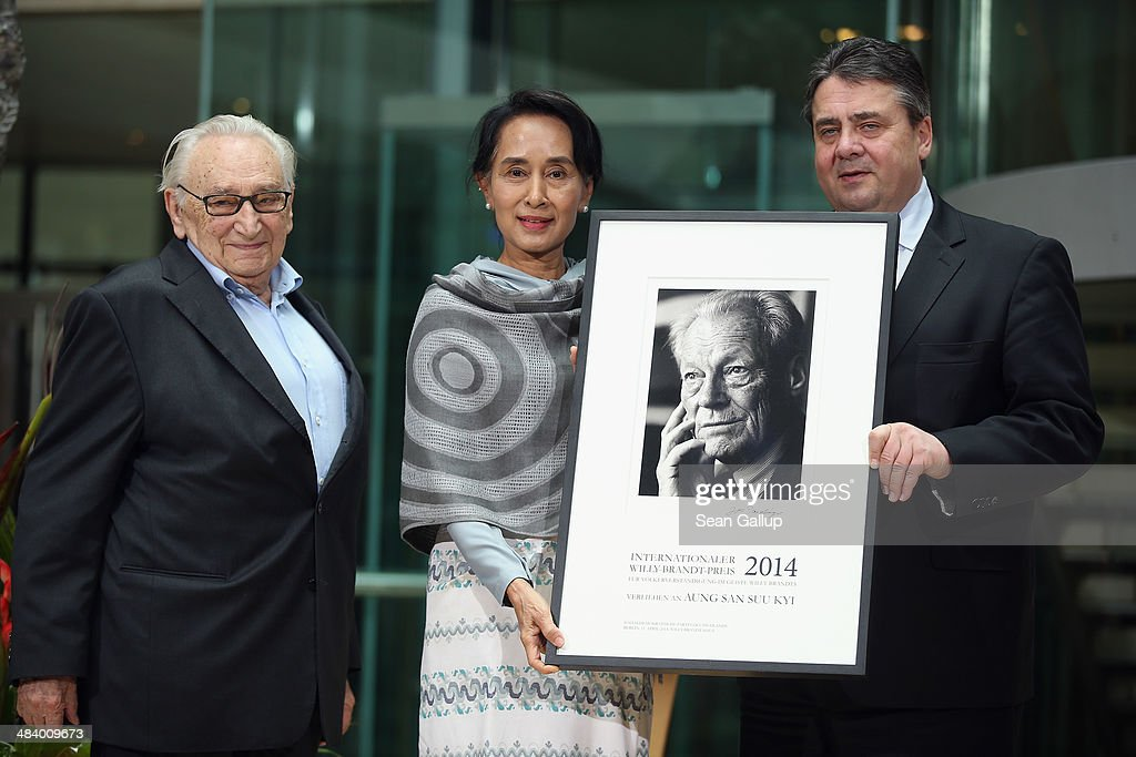 Myanmar human rights activist and politician Aung San Suu Kyi (C) receives the International Willy Brandt Award from Vice Chancellor and Economy and Energy Minister as well as Chairman of the German Social Democrats (SPD) Sigmar Gabriel (R) and former SPD politician Egon Bahr at Willy Brandt Haus on April 11, 2014 in Berlin, Germany. Aung San Suu Kyi is visiting Berlin for the first time before she continues next week to France.
