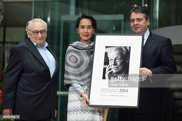 Myanmar human rights activist and politician Aung San Suu Kyi receives the International Willy Brandt Award from Vice Chancellor and Economy and...
