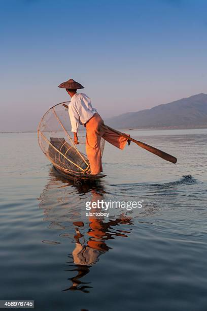 myanmar: inle lake fisherman showing unique leg-rowing technique - myanmar culture stock pictures, royalty-free photos & images