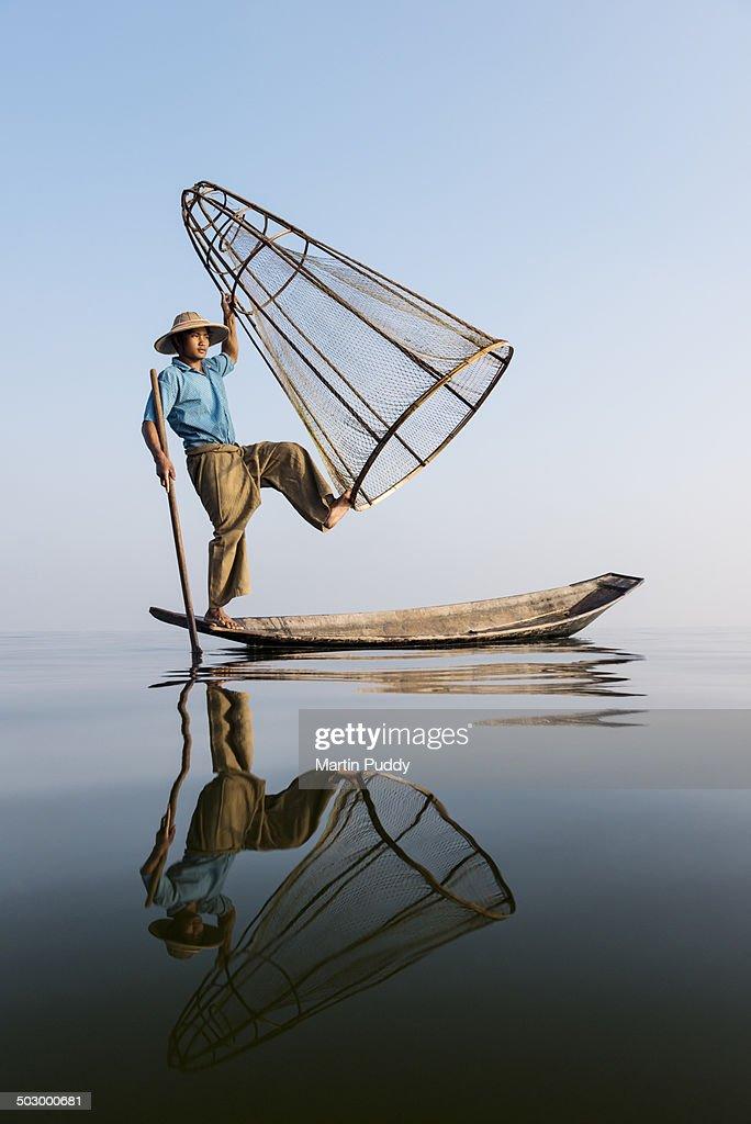 Myanmar, Inle lake, traditional fisherman on boat : Stock Photo