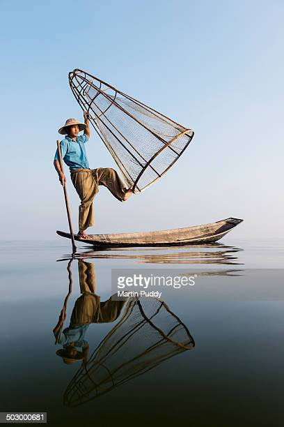 Myanmar, Inle lake, traditional fisherman on boat
