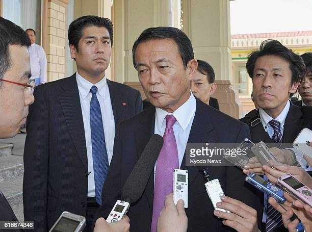 Myanmar - Japanese Deputy Prime Minister and Finance Minister Taro Aso answers reporters' questions after holding talks with Myanmar President Thein...