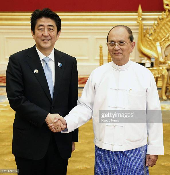 Myanmar - Japanese Prime Minister Shinzo Abe and Myanmar President Thein Sein shake hands prior to their talks in Naypyitaw, Myanmar, on May 26, 2013.