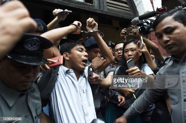 Myanmar journalist Kyaw Soe Oo is escorted by police after being sentenced by a court to jail in Yangon on September 3 2018 Two Reuters journalists...