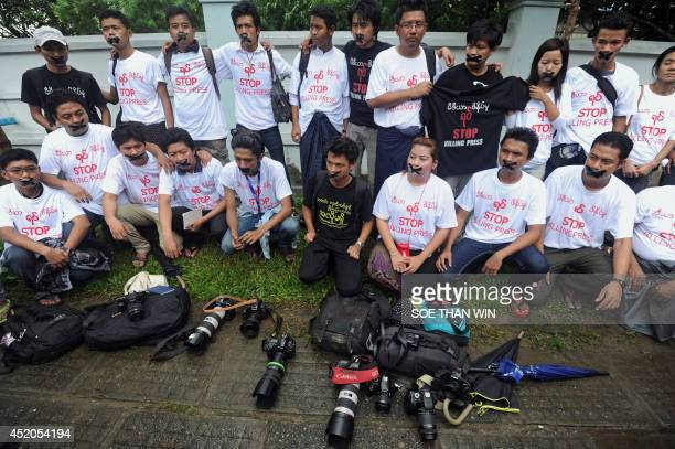 Myanmar journalists wearing Tshirts that say 'Stop Killing Press' stage a silent protest for five journalists who were jailed for 10 years on July 10...