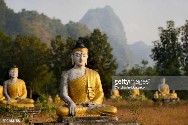 myanmar, kayin (karen) state, hpa-an, lumbini park, buddha statues - buddha state stock pictures, royalty-free photos & images