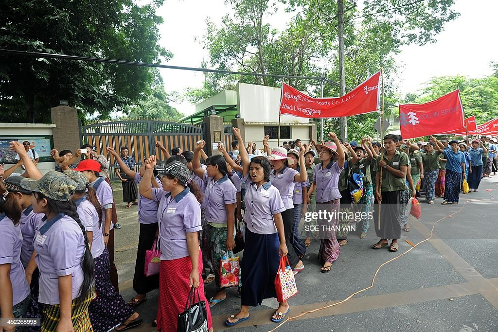 Myanmar labourers from a shoe factory stage a rally in